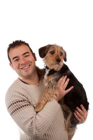 beagle mix: Portrait of a man holding a cute mixed breed dog isolated over white.