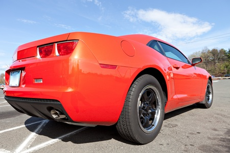 custom car: Rear close up of a modern orange sports car. Editorial