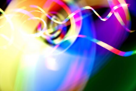 Abstract rainbow colored light streaks isolated over a dark black background. Stock Photo - 13452915