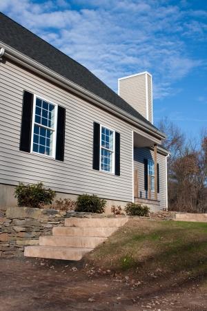 Modern custom built house newly constructed in a residential neighborhood. Stock Photo - 14014174
