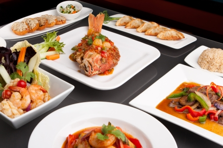 Freshly prepared Thai style whole fish red snapper sweet and sour shrimp gyoza dumplings sesame breads and other spicy Thai dishes.