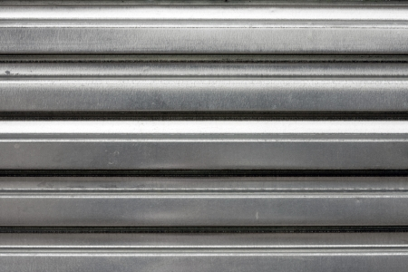 corrugated steel: Silver corrugated metal texture  Makes a great grungy background or backdrop.