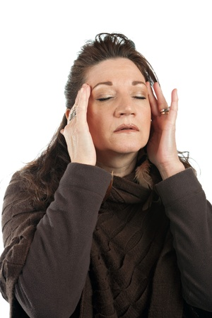 stressed out: This woman has a stressed out look on her face while holding her hands on her head and temples.