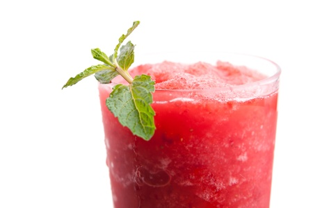 Red fruit flavored frozen cocktail or smoothie beverage with straw and stirring stick.