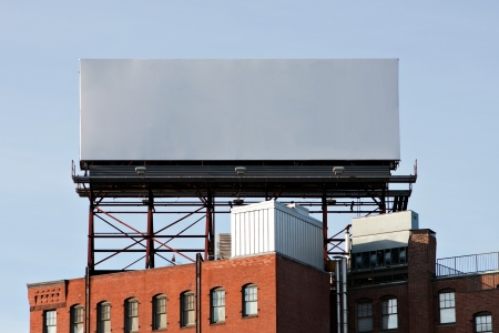 signage outdoor: A large blank urban billboard with copy space ready for your design or mock up text.  Stock Photo