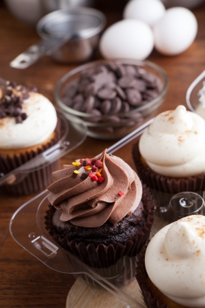 baked goods: Close up of some decadent gourmet cupcakes frosted with a variety of frosting flavors.