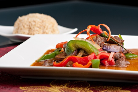 beef curry: A beautifully presented dish of Thai food with mixed vegetables beef and brown rice.