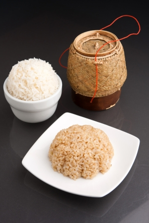 Different kinds of Thai style rices prepared including white jasmine and brown rice. Stock Photo