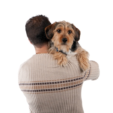 Portrait of a man holding a cute mixed breed dog over his shoulder isolated over white. photo