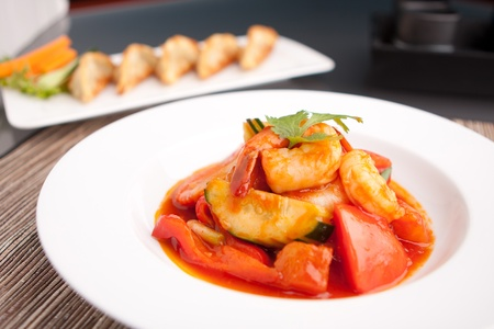 sweet and savoury: Thai style sweet and sour shrimp dish presented beautifully on a round white plate.