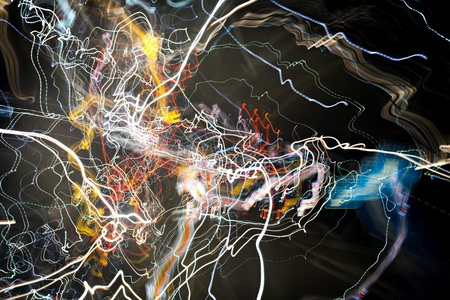 Some abstract and colorful glowing trails of glowing light.
