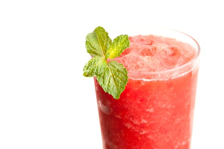 liquefied: Red fruit flavored frozen cocktail or smoothie beverage with straw and stirring stick.