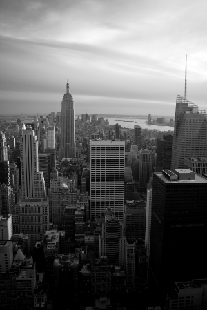 Skyline vew of the Manhattan section of New York City in black and white around dusk.
