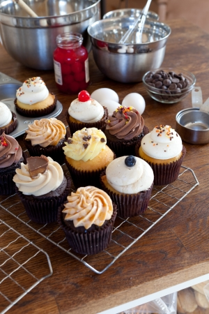 cakes and pastries: Close up of some decadent gourmet cupcakes frosted with a variety of frosting flavors.