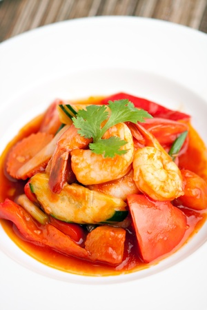 Thai style sweet and sour shrimp dish presented beautifully on a round white plate. Stock Photo - 20209284