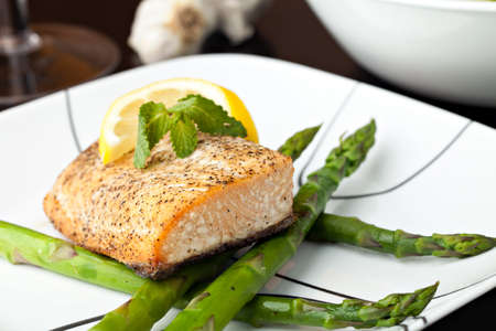 Freshly prepared salmon fish filet grilled and seasoned to perfection. photo