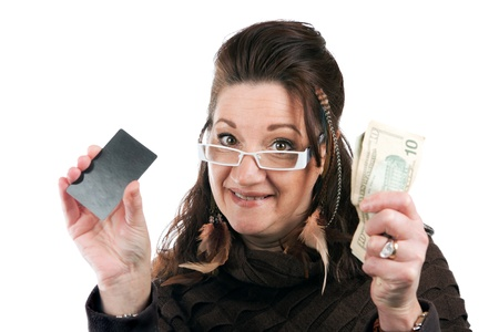 cash card: Brunette woman holding up a blank credit card business card shoppers club card or gift card of some sort along with some cash in her other hand. Stock Photo
