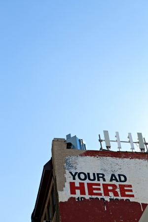 Your ad here sign as seen on the side of an old city building. Plent of copy space for your text or mockup ad design.