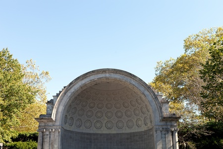 concave: Public music shell stage located in Central Park NYC.