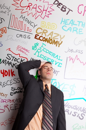 troublesome: A business man that looks worried about money and the troublesome economic times we are living in. Stock Photo