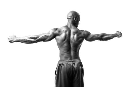 lean over: Toned and ripped lean muscle fitness man isolated over a white background in high contrast black and white.