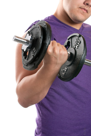 pumping: A young man curling a dumbbell over a white background.