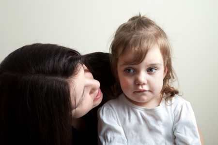 Toddler age girl getting spoken to by her mother. Great parenting concept image. Imagens
