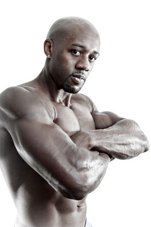 Toned and ripped lean muscle fitness body builder isolated over a white background. photo