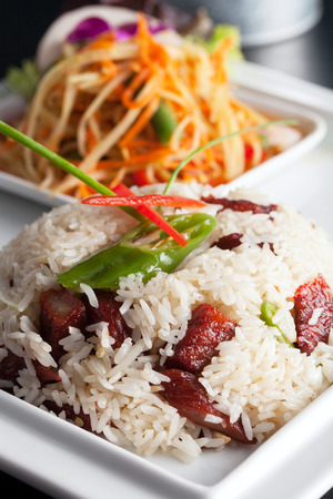 Traditional dish of freshly prepared Thai food.  Thai Sausage and som tum green papaya salad. photo