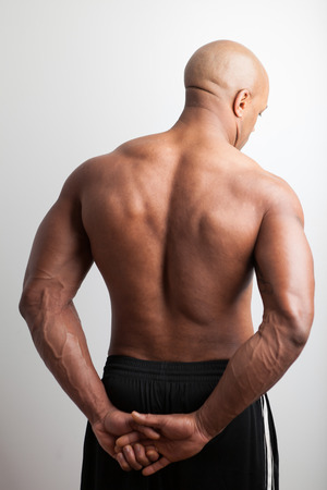 Portrait of a muscle fitness mans back and shoulders. photo