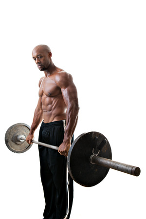 body builder: Toned and ripped lean muscle fitness man lifting weights isolated over a white background.