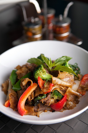 beef curry: Pad kee mao drunken noodle thai dish with beef and mixed vegetables.