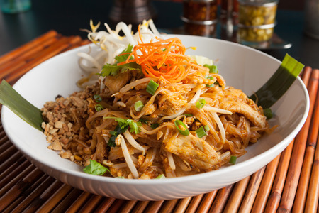thai noodle: Chicken pad Thai dish of stir fried rice noodles with a contemporary presentation. Stock Photo