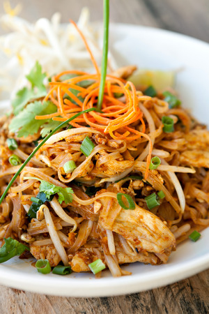 pad: Chicken pad Thai dish of stir fried rice noodles with a contemporary presentation. Stock Photo