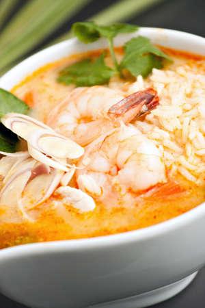 Thai shrimp soup bowl with nice garnish. Shallow depth of field.