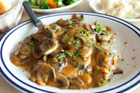 Chicken marsala dish with mashed potatoes and veg.
