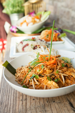 asian food: Chicken pad Thai dish of stir fried rice noodles with a contemporary presentation. Stock Photo