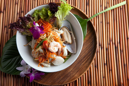 Traditional dish of freshly prepared Thai food.  Thai seafood and som tum green papaya salad.