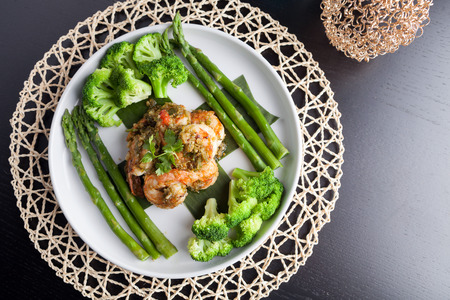 Shrimp scampi seafood dish with broccoli and asparagus. photo