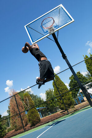 baller: Young basketball player drives to the hoop with some fancy moves.