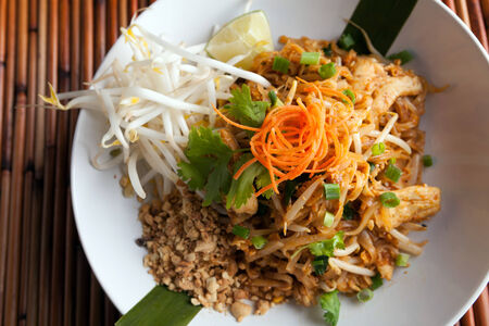 Chicken pad Thai dish of stir fried rice noodles with a contemporary presentation. photo