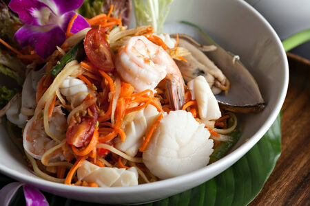 Traditional dish of freshly prepared Thai food.  Thai seafood and som tum green papaya salad.