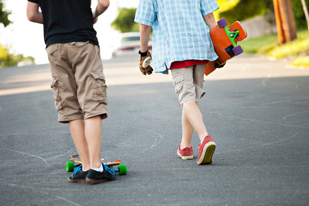 boarders: Close up of some long boarders on an urban road. Stock Photo