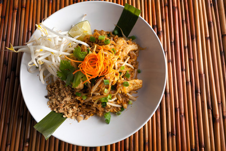 stir fried: Chicken pad Thai dish of stir fried rice noodles with a contemporary presentation. Stock Photo