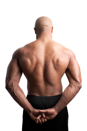 flex: Toned and ripped body builder with a muscular back. Stock Photo