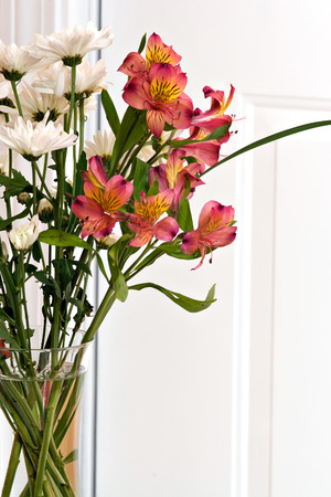 Close Up Of A Flower Arrangement With Lillies In A Clear Vase Stock