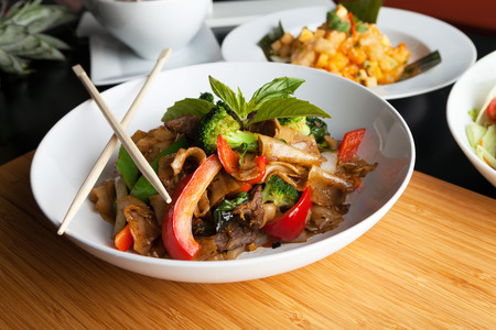 thai pepper: Pad kee mao drunken noodle thai dish with beef and mixed vegetables.