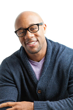african american male: Stylish African American man wearing black framed glasses. Shallow depth of field.