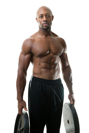 jacked: Toned and ripped lean muscle fitness man lifting plate weights isolated over a white background.