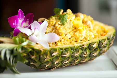 thailand fruit: Freshly prepared pineapple fried rice served inside of a pineapple carved like a bowl.